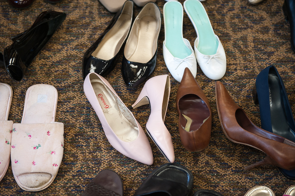 The Womens Center provides large female shoes for men to pick from for the Walk a Mile in Her Shoes event. Phot by Elizabeth Held