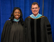 Booker T Washington High School principal LaShonda Bilbo-Ervin and Houston ISD Superintendent Dr. Terry Grier pose for a photograph after commencement at Delmar Fieldhouse, June 8, 2013.