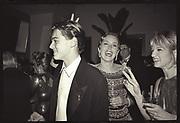 Leonardo DiCaprio, Sharon Stone & Ellen Barkin  at  Producer Steve Tisch &  Vanity Fair's Oscar Night Party,<br /> Mortons,  Los Angeles. March 1994.  Film 94559/25