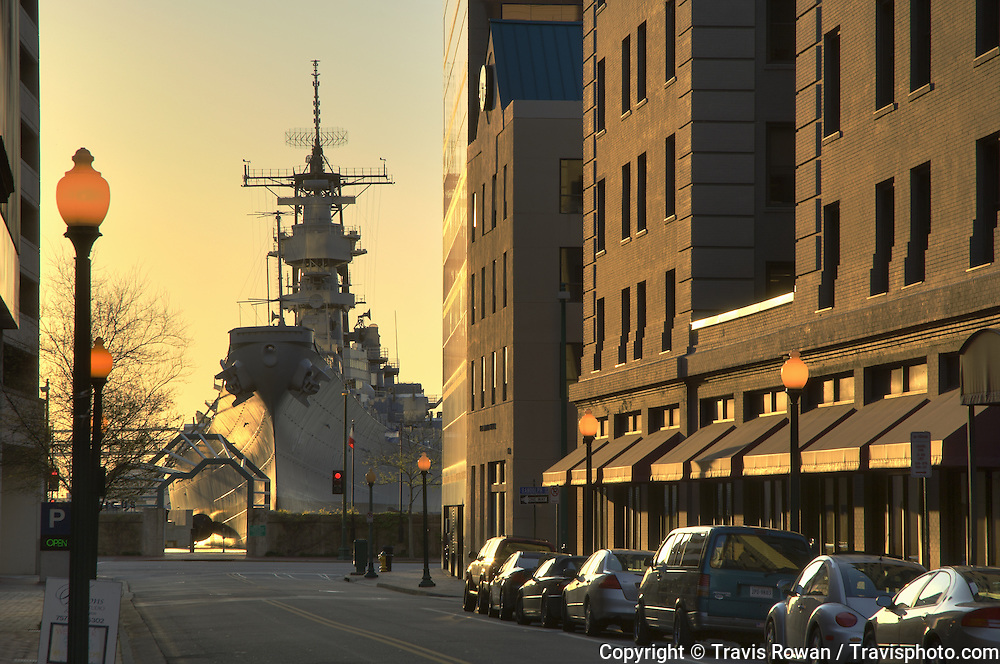 The battleship USS Wisconsin juxtaposed among the highrise buildings in downtown Norfolk, Virginia.