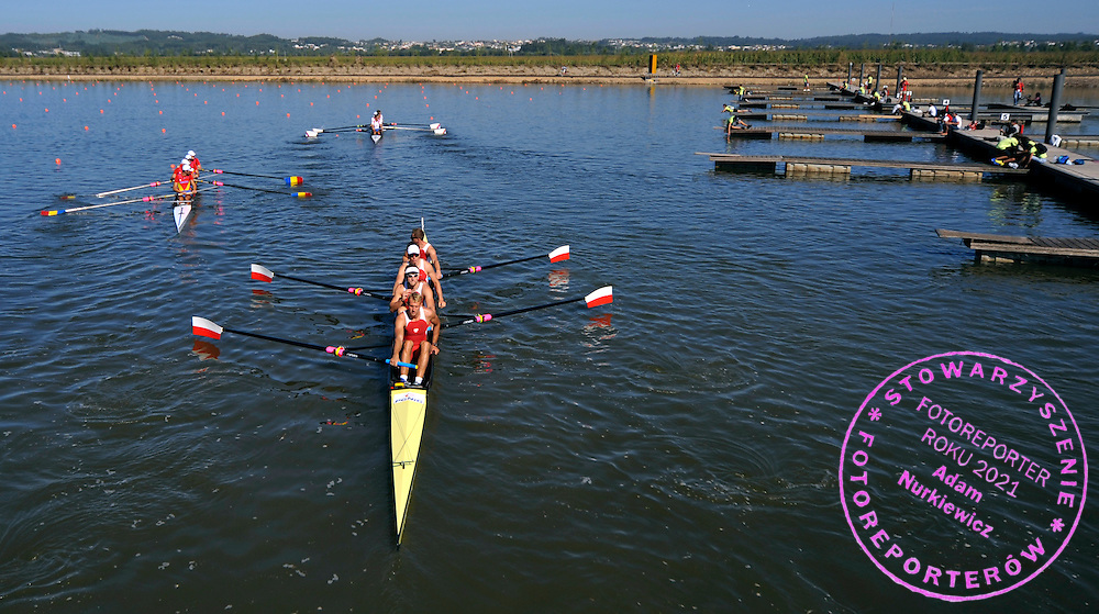 (STROKE) PATRYK BRZEZINSKI & RYSZARD ABLEWSKI & SEBASTIAN KOSIOREK & DARIUSZ RADOSZ (ALL POLAND) WARM UP BEFORE START IN MEN'S FOUR DURING REGATTA EUROPEAN ROWING CHAMPIONSHIPS IN MONTEMOR-O-VELHO, PORTUGAL...PORTUGAL , MONTEMOR-O-VELHO , SEPTEMBER 10, 2010..( PHOTO BY ADAM NURKIEWICZ / MEDIASPORT ).