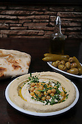 A plate of Humus Tehina and pickles
