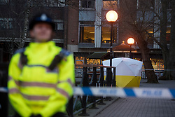 © Licensed to London News Pictures. 06/03/2018. Salisbury, UK. A police officer stands in front of a police tent covering a park bench near the Maltings shopping centre in Salisbury where former Russian spy Sergei Skripal and a woman in her 30s were taken ill with suspected poisoning. The couple where found unconscious on bench in Salisbury shopping centre. Specialist units have been called in to deal with any possible contamination. Photo credit: Ben Cawthra/LNP