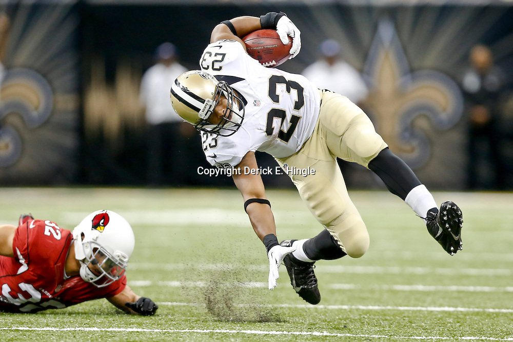 Sep 22, 2013; New Orleans, LA, USA; New Orleans Saints running back Pierre Thomas (23) breaks away from Arizona Cardinals defensive back Tyrann Mathieu (32) during the second half of a game at Mercedes-Benz Superdome. The Saints defeated the Cardinals 31-7. Mandatory Credit: Derick E. Hingle-USA TODAY Sports