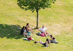 © Licensed to London News Pictures;01/06/2020; Bristol, UK. A group of six people sit in Perrett Park in Knowle during the heatwave on the first meteorological day of summer. From today the UK Government has eased some of the covid-19 coronavirus pandemic restrictions, including that groups of up to six people from different households can now meet outside if they practice social distancing which is currently 2m between people from different households. Photo credit: Simon Chapman/LNP.
