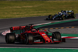 February 28, 2019 - Barcelona, Catalonia, Spain - Charles Leclerc from Monaco with 16 of Scuderia Ferrari Mission Winnow SF90 in action and Valtteri Bottas fo Finland with 77 of Mercedes AMG Petronas Motorsport W10 in action   during the Formula 1 2019 Pre-Season Tests at Circuit de Barcelona - Catalunya in Montmelo, Spain on February 28. (Credit Image: © Xavier Bonilla/NurPhoto via ZUMA Press)