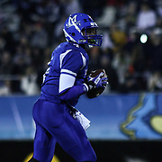 Middletown Quarterback Darius Wade (4) attempts to throw a pass in the third quarter of the DIAA State Championship football game against Salesianum Saturday, Nov. 30 2013, at Delaware Stadium in Newark Delaware.