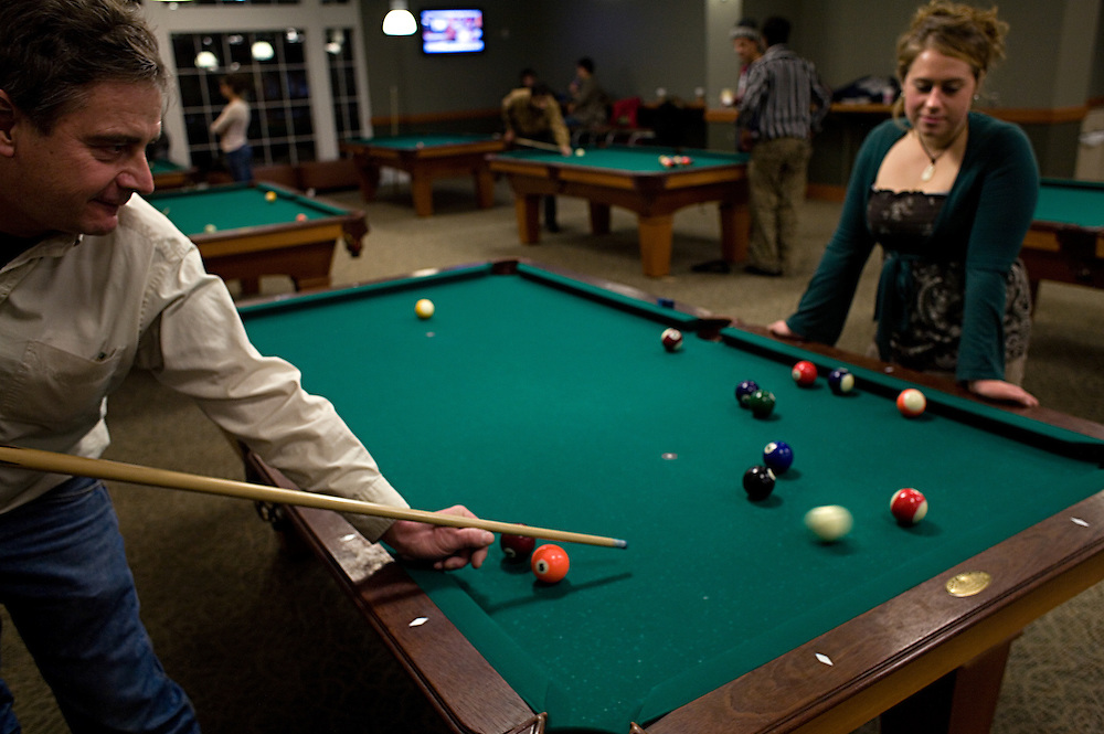 Robert Spilker plays pool with his daughter Ashley Spilker on Dad's Weekend in Baker Center in Athens, Ohio on Friday, Jan. 25, 2008. ( /CHAD BARTLETT)