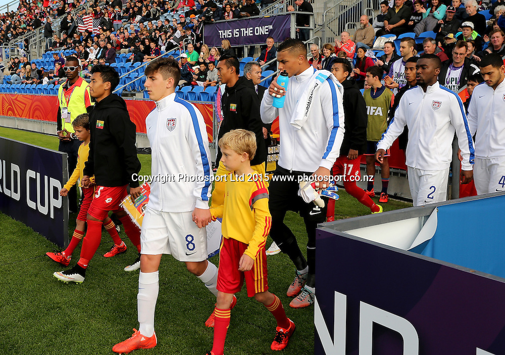 Captain Emerson Hyndman of USA leads his team onto the pitch for the Group A FIFA U20 World Cup Match between USA and Myanmar at Northlands Event Centre, Whangarei, Northland, New Zealand, Saturday, May 30, 2015. Copyright photo: David Rowland / www.photosport.co.nz