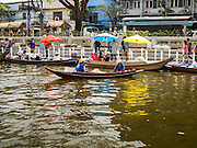 12 FEBRUARY 2015 - BANGKOK, THAILAND:  A grilled meat vendor paddles his boat down a new floating market opened on Khlong Phadung Krung Kasem, a 5.5 kilometre long canal dug as a moat around Bangkok in the 1850s. The floating market opened at the north end of the canal near Government House, which is the office of the Prime Minister. The floating market was the idea of Thai Prime Minister General Prayuth Chan-ocha. The market will be open until March 1.    PHOTO BY JACK KURTZ