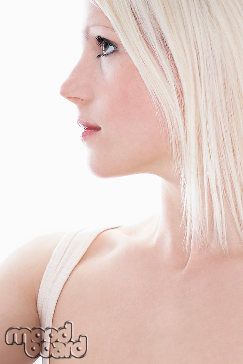 Studio shot of young woman close-up