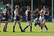 Worcester Perry Humphreys  Wing (14) left and Chris Pennell  Full back (15) right celebrate the 25-19 win during the Aviva Premiership match between Worcester Warriors and Bath Rugby at Sixways Stadium, Worcester, United Kingdom on 15 April 2017. Photo by Gary Learmonth.