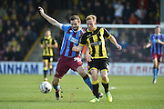 Jamie Ness of Scunthorpe United under attack from Burton Albion midfielder on loan from Birmingham City Mark Duffy (21)  during the Sky Bet League 1 match between Scunthorpe United and Burton Albion at Glanford Park, Scunthorpe, England on 9 April 2016. Photo by Ian Lyall.