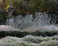 Frost covered plants next to a stone urn in the Italian Garden at Chiswick House, Chiswick, London, UK