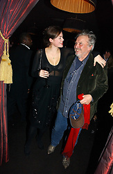 JASMINE GUINNESS and DAVID BAILEY at a Black, White and Gold party to celebrate the December 'Party' issue of Harper's Bazaar featuring the 'Going Out' Guide in association with Moet & Chandon  held at Ronnie Scotts, 47 Frith Street, London on 16th November 2006.<br />