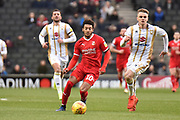 Swindon Town forward Keshi Anderson (10) looks to release the ball during the EFL Sky Bet League 2 match between Milton Keynes Dons and Swindon Town at stadium:mk, Milton Keynes, England on 9 February 2019.
