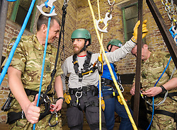 Tom Hardy abseils with the Royal Marines. Tuesday, 25th February 2014. Picture by Anthony Upton / i-Images<br /> <br /> TOM HARDY DROPS IN ON ROYAL MARINES PREPARING FOR BT CHARITY ABSEIL<br /> <br /> Hollywood actor Tom Hardy, dropped in on Royal Marines training volunteers at the Castle, a London climbing centre as part of their preparations to abseil down the iconic BT Tower, on 10th March 2014, the venue for a 138 metres charity abseil to raise money for Sports Relief and the Royal Marines Charitable Trust Fund.<br /> <br /> The team will abseil from the 29th floor of BT Tower will include intrepid adventurer, Bear Grylls, TV presenter Helen Skelton, former Lion and England rugby world cup winner Ben Kay, former England rugby star Martin Bayfield and Olympic and World Champion swimmer Mark Foster.  Gavin Patterson, BT CEO will lead the charge on behalf of BT, with Major General Ed Davis CBE leading the Royal Marines.