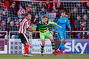 Lincoln City forward Matt Rhead (9) holds onto Forest Green Rovers defender Mark Roberts (21)  during the EFL Sky Bet League 2 match between Lincoln City and Forest Green Rovers at Sincil Bank, Lincoln, United Kingdom on 30 December 2017. Photo by Simon Davies.