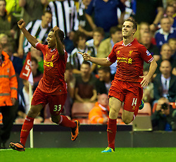 27.08.2013, Anfield, Liverpool, ENG, League Cup, FC Liverpool vs Notts County FC, 2. Runde, im Bild Liverpool's Jordan Henderson celebrates with team-mate Jordon Ibe after scoring his side's fourth goal against Notts County during the English League Cup 2nd round match between Liverpool FC and Notts County FC, at Anfield, Liverpool, Great Britain on 2013/08/27. EXPA Pictures © 2013, PhotoCredit: EXPA/ Propagandaphoto/ David Rawcliffe<br /> <br /> ***** ATTENTION - OUT OF ENG, GBR, UK *****