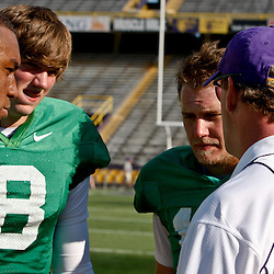 April 9, 2011; Baton Rouge, LA, USA; LSU Tigers quarterbacks (left to right)LSU Tigers quarterback Jordan Jefferson, Zach Mettenberger, and Jarrett Lee talk with offensive coordinator Steve Kragthorpe during the 2011 Spring Game at Tiger Stadium.   Mandatory Credit: Derick E. Hingle
