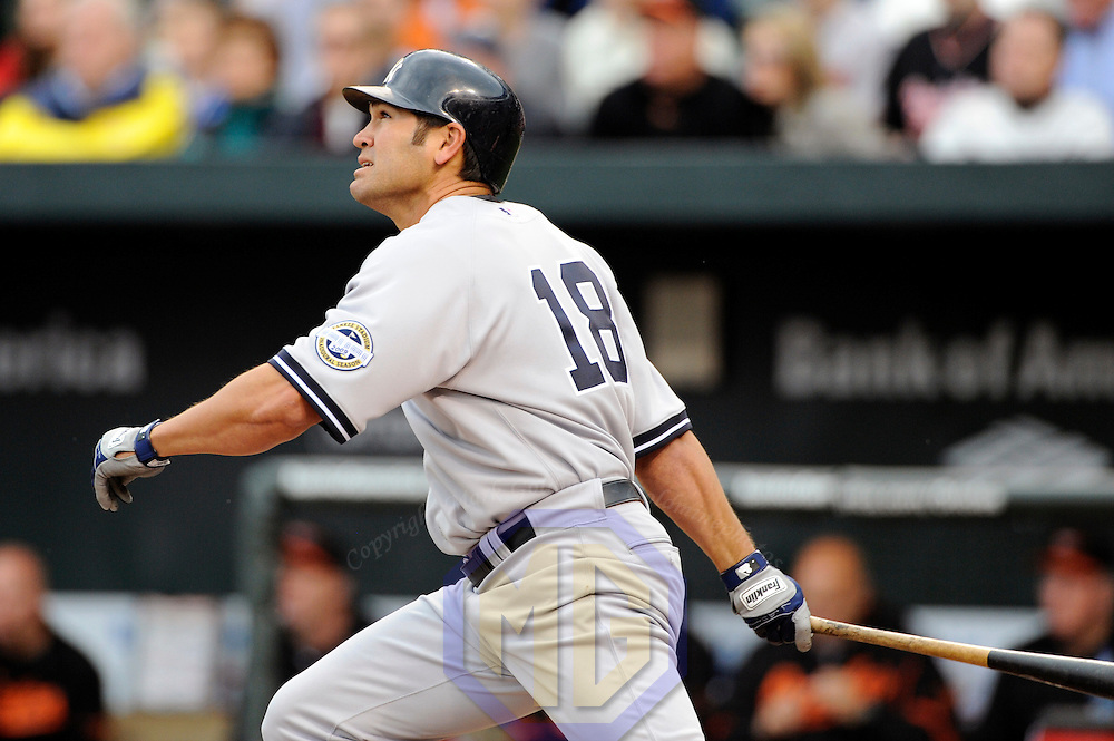 06 April 2009:  New York Yankees left fielder Johnny Damon (18) hits a sacrifice fly ball to left field to score center fielder Brett Gardner in the 3rd inning against the Baltimore Orioles at Camden Yards in Baltimore, MD.  The Orioles defeated the Yankees 10-5 in the home opener to start the major league regular season.  ****For Editorial Use Only****