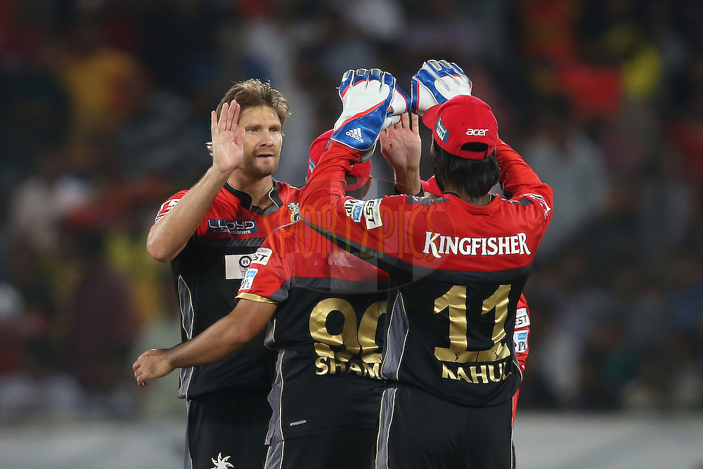 Shane Watson of Royal Challengers Bangalore and KL Rahul of Royal Challengers Bangalore celebrate getting Kane Williamson of Sunrisers Hyderabad wicket during match 27 of the Vivo IPL 2016 (Indian Premier League) between the Sunrisers Hyderabad and the Royal Challengers Bangalore held at the Rajiv Gandhi Intl. Cricket Stadium, Hyderabad on the 30th April 2016<br /> <br /> Photo by Shaun Roy / IPL/ SPORTZPICS