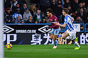Felipe Anderson of West Ham United (8) tries to get past Eric Durm of Huddersfield Town (37) during the Premier League match between Huddersfield Town and West Ham United at the John Smiths Stadium, Huddersfield, England on 10 November 2018.