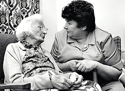 Care worker and elderly woman, Loughborough UK May 1988