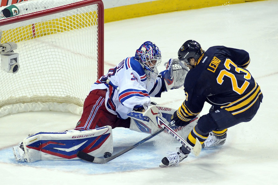 New York Rangers goalie Henrik Lundqvist (30) makes the save with his pads on the shot by Buffalo Sabres center Ville Leino (23) during the shoot-out period at the First Niagara Center in Buffalo, New York. The New York Rangers defeated the Buffalo Sabres 1-0 after going into a shoot out.