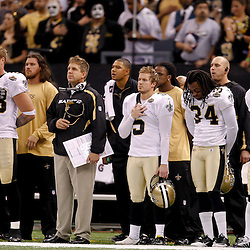 September 9, 2010; New Orleans, LA, USA;  New Orleans Saints head coach Sean Payton and players stand for the national anthem prior to kickoff of the NFL Kickoff season opener at the Louisiana Superdome. The New Orleans Saints defeated the Minnesota Vikings 14-9.  Mandatory Credit: Derick E. Hingle