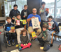 Children's author Oisin McCann pictured with some young book fans at the Rolling Sun Festival event at Westport Library on saturday last in Westport Pic Conor McKeown.