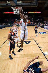 Virginia Cavaliers F/C Jerome Meyinsse (55) dunks against Carson-Newman.  The Virginia Cavaliers men's basketball team defeated the Carson-Newman Eagles 124-65 in an exhibition basketball game at the John Paul Jones Arena in Charlottesville, VA on November 4, 2007.