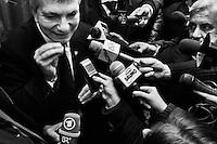 """ROME, ITALY - 24 JANUARY 2013: Nichi Vendola, leader of the """"Left Ecology Freedom"""" list of the center-left coalition, answers to media questions after a press conference given together with members of the center-left coalition Pierluigi Bersani (PD - Democratic Party, leader running for Prime Minister) and Bruno Tabacci (Democratic Center) at the Ripetta Residence in Rome, on January 24, 2013. Pierluigi Bersani, running for Prime Minister in the 2013 elections in Italy, said he wouldn't dump his ally Nichi Vendola for former PM Mario Monti.  A general election to determine the 630 members of the Chamber of Deputies and the 315 elective members of the Senate, the two houses of the Italian parliament, will take place on 24–25 February 2013. The main candidates running for Prime Minister are Pierluigi Bersani (leader of the centre-left coalition """"Italy. Common Good""""), former PM Mario Monti (leader of the centrist coalition """"With Monti for Italy"""") and former PM Silvio Berlusconi (leader of the centre-right coalition). ### ROMA, ITALIA - 24 GENNAIO 2013: Nichi Vendola, leader della lista """"Sinistra Ecologia Libertà"""" risponde alle domande della stampa dopo una conferenza stampa presieduta insieme ai membri della coalition di centro-sinistra Pierluigi Bersani (PD - Partito Democratico, leader candidate alla Presidenza del Consiglio) e Bruno Tabacci (Centro Democratico) al Residence Ripetta a Roma, il 24 gennaio 2013. Le elezioni politiche italiane del 2013 per il rinnovo dei due rami del Parlamento italiano – la Camera dei deputati e il Senato della Repubblica – si terranno domenica 24 e lunedì 25 febbraio 2013 a seguito dello scioglimento anticipato delle Camere avvenuto il 22 dicembre 2012, quattro mesi prima della conclusione naturale della XVI Legislatura. I principali candidate per la Presidenza del Consiglio soon Pierluigi Bersani (leader della coalizione di centro-sinistra """"Italia. Bene Comune""""), il premier uscente Mario Monti (leader della coalizione di cent"""