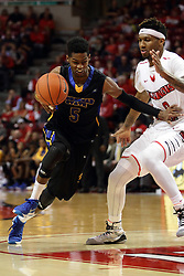 16 November 2015: Miguel Dicent takes the paint guarded by Nick Banyard(0). Illinois State Redbirds host the Morehead State Eagles at Redbird Arena in Normal Illinois (Photo by Alan Look)
