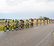 NL, July 5 2015:  The race rides past on Vrijheidsweg towards Zelande (NL) during Stage 2 of the 2015 Tour de France.<br /> Copyright 2015 Peter Horrell.