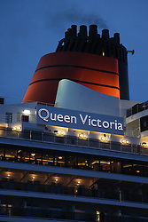 © Licensed to London News Pictures. 09/05/2014. Southampton, UK. The red funnel of the Queen Victoria cruise liner. Firework celebrations marking the 10-year anniversary of the Cunard flagship, Queen Mary 2, take place in the port of Southampton this evening, 9th May 2014. All 'three queens' of the Cunard fleet were present at the event, which included a 10-minute firework display, one minute for every year that the QM2 has been in service. Photo credit : Rob Arnold/LNP