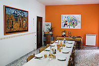 CASERTA, ITALY - 25 FEBRUARY 2015: A table set for lunch is here in one of the rooms of Casa Ruta, a shelter for abused young immigrant women in Caserta, Italy, on February 25th 2015.<br /> <br /> Casa Rut was founded in 1995 and it is promoted and managed by the Ursuline Sisters of the Sacred Heart of Mary of Breganze (Vicenza, Italy).  Casa Rut's goal is to provide young immigrant women a familiar environment where  they are helped to protect and free themselves, and to undertake a common path aiming to the integration in Italy's society.