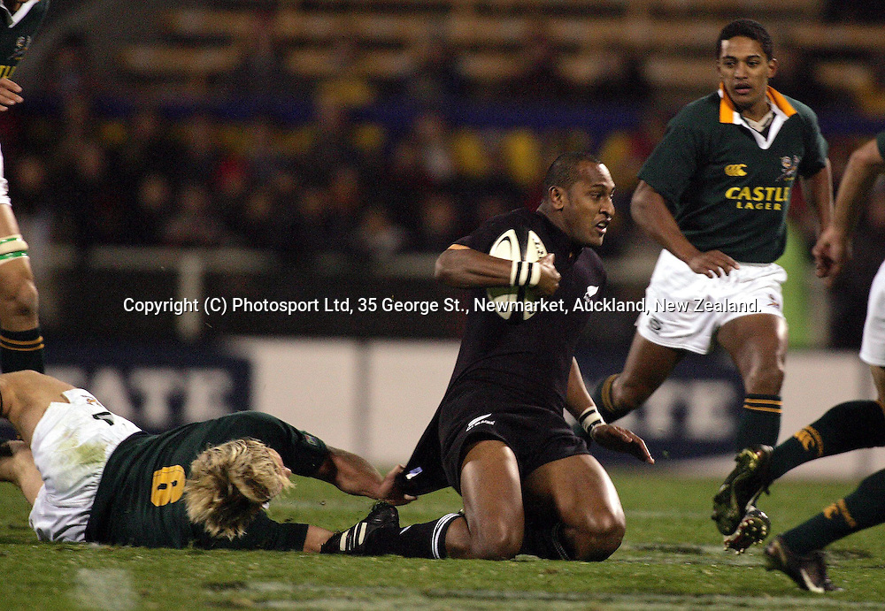 Joe Rokocoko during the Tri Nations Test match between the All Blacks and the South African Springboks at Jade Stadium, Christchurch, New Zealand, on Saturday 24 June, 2004. The All Blacks defeated South Africa, 23 - 21.<br />PHOTOSPORT PHOTO: Hannah Johnston