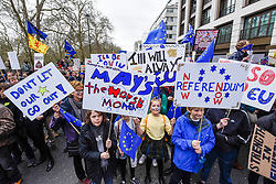 "© Licensed to London News Pictures. 23/03/2019. LONDON, UK.  Signs carried overhead as thousands of people take part in the ""Put It To The People March"", marching from Park Lane to Parliament Square on what was supposed to be six days before the UK was due to leave the EU, before an extension to the departure date was given.  Protesters demand that the public is given a final say on Brexit as support for the Prime Minister's withdrawal plan continues to recede.  Photo credit: Stephen Chung/LNP"