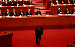 epa06272462 Chinese President Xi Jinping bows before making his speech during the opening ceremony of the 19th National Congress of the Communist Party of China (CPC) at the Great Hall of the People (GHOP) in Beijing, China, 18 October 2017.  China holds the 19th Congress of the Communist Party of China, the country's most important political event where the party's leadership is chosen and plans are made for the next five years. Xi Jinping is expected to remain as the General Secretary of the Communist Party of China for another five-year term.  EPA-EFE/HOW HWEE YOUNG