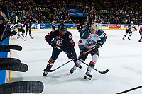 KELOWNA, CANADA - MARCH 24: Jermaine Loewen #32 of the Kamloops Blazers stick checks Kole Lind #16 of the Kelowna Rockets in front of the bench on March 24, 2017 at Prospera Place in Kelowna, British Columbia, Canada.  (Photo by Marissa Baecker/Shoot the Breeze)  *** Local Caption ***
