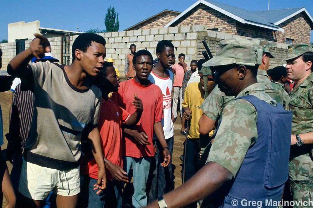 Bekkersdal Township, South Africa, Feb 1994: Riot Police patrol during three way clashes between security forces, ANC members and  AZAPO supporters in the far West Rand township of Bekkerdal, South Africa.