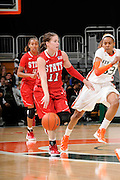 January 5, 2012: Emili Tasler #11 of North Carolina State in action during the NCAA basketball game between the Miami Hurricanes and the North Carolina State Wolfpack at the BankUnited Center in Coral Gables, FL. The Hurricanes defeated the Wolfpack 78-68.