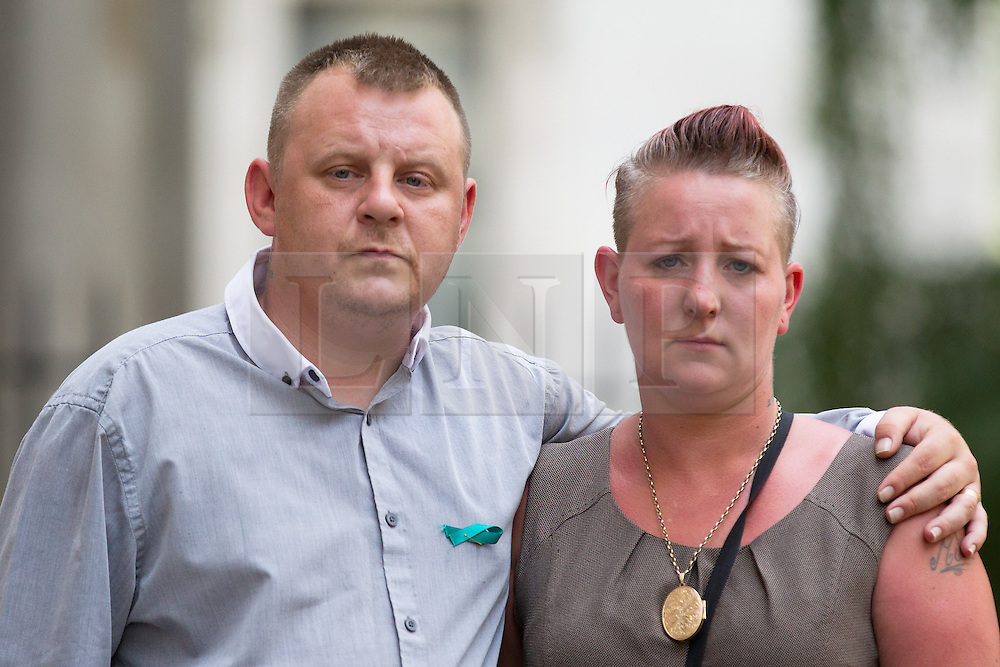© Licensed to London News Pictures. 16/07/2013. London, UK. Shirley (R) and Michael Anderson (L), the parents of Jade Anderson, who was mauled to death by dogs, stand in Downing Street after handing in a petition to Number 10 Downing Street today (16/07/2013) calling on the Government to take more action on dangerous dogs. Photo credit: Matt Cetti-Roberts/LNP