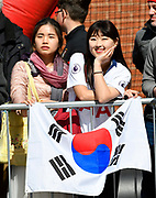 Two girls with a Korean flag as they wait for the Tottenham team bus to arrive before the Premier League match between Bournemouth and Tottenham Hotspur at the Vitality Stadium, Bournemouth, England on 4 May 2019.