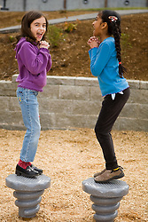 United States, Washington, Bellevue, girls (age 8) in school playground
