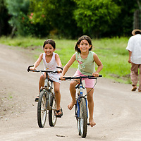 Kids playing in the streets of the town of Rincon Santo in the region of Ocu, Province of Herrera, Republic of Panama.  Ocu is an area of the country well known for the fabrication of typical Panamanian dress.