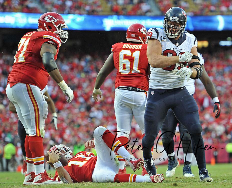 Defensive end J.J. Watt #99 of the Houston Texans reacts after sacking quarterback Alex Smith #11 of the Kansas City Chiefs during the second half  at Arrowhead Stadium in Kansas City, Missouri.