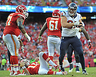 Defensive end J.J. Watt #99 of the Houston Texans reacts after sacking quarterback Alex Smith #11 of the Kansas City Chiefs during the second half  at Arrowhead Stadium in Kansas City, Missouri.