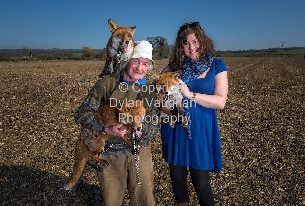 11/3/14<br /> Michelle Fleming pictured with Patsy Gibbons and his foxes Grainne (on Patsy's shoulder), Henry (held by Patsy) and Minnie (held by Michelle) in Thomastown County Kilkenny.<br /> Picture Dylan Vaughan.